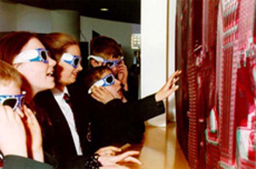 children viewing a large image wearing 3D-glasses