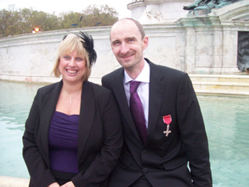 Phil and Maxine outside Bckingham Palace after receivinig his MBE for services to science education